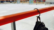 Clipa purse hook on rails at a Hockey Rink