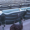 purse hanging from stadium chair using the Clipa